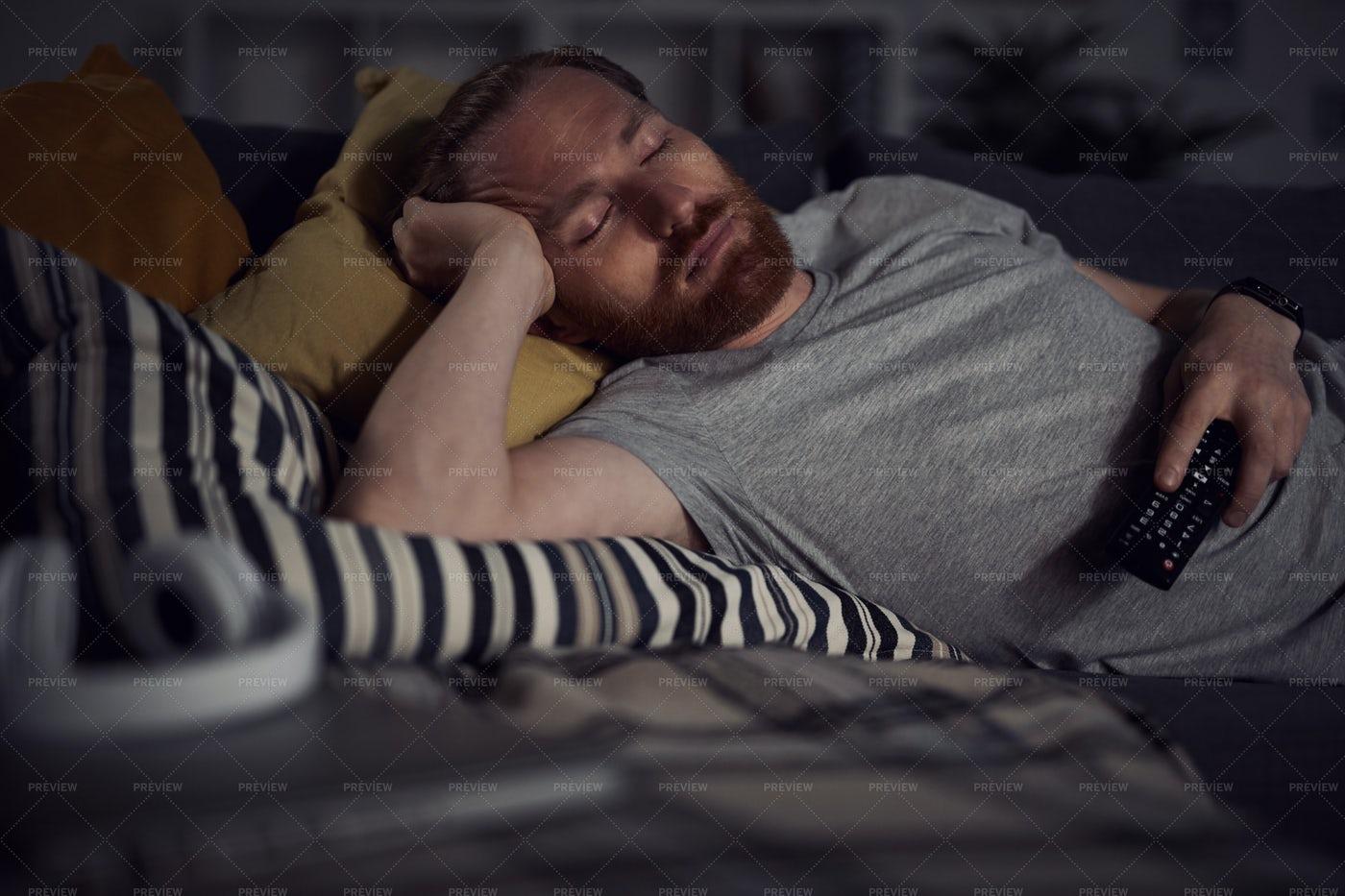 Falling Asleep By TV: Stock Photos