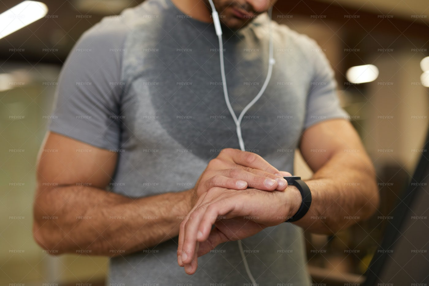 Man Using Smartwatch In Gym Closeup: Stock Photos