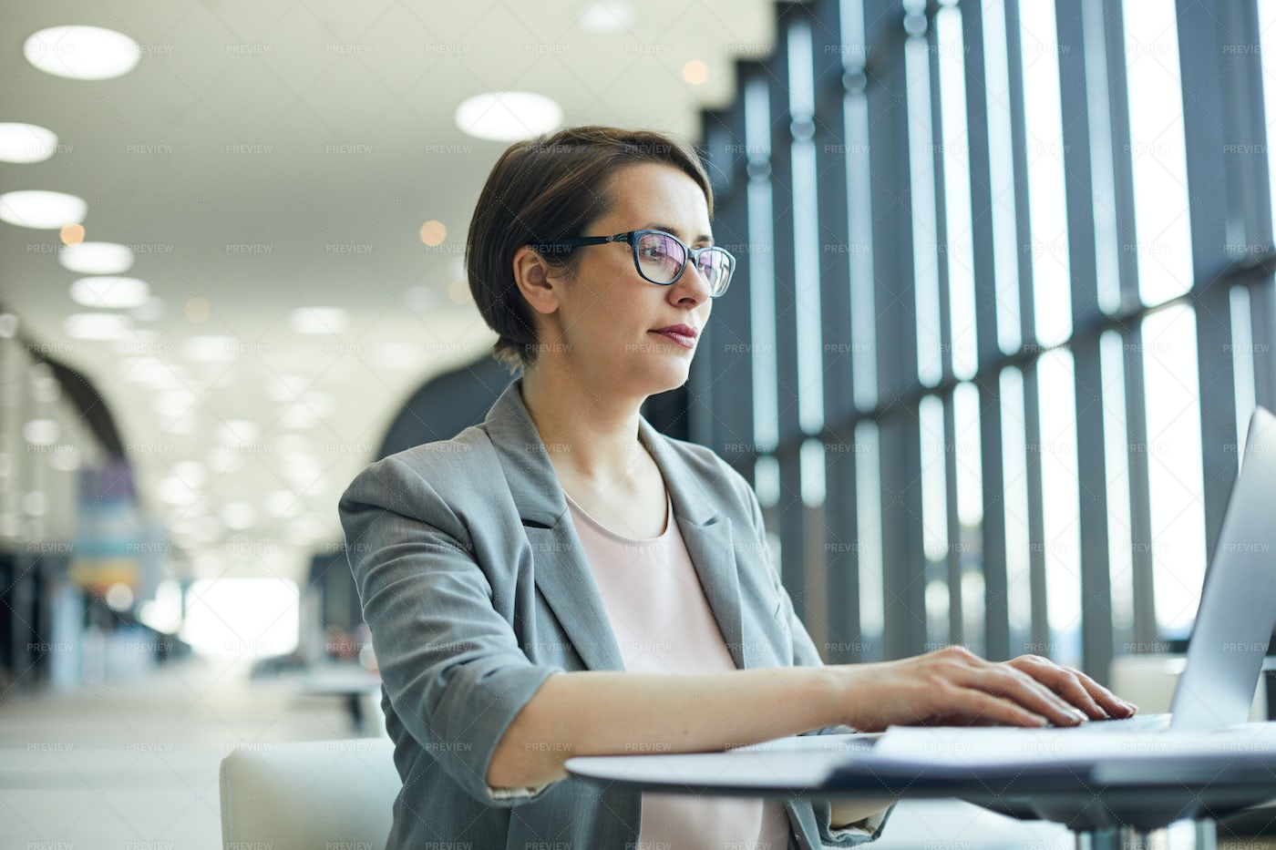 Business Lady Working In Lobby: Stock Photos
