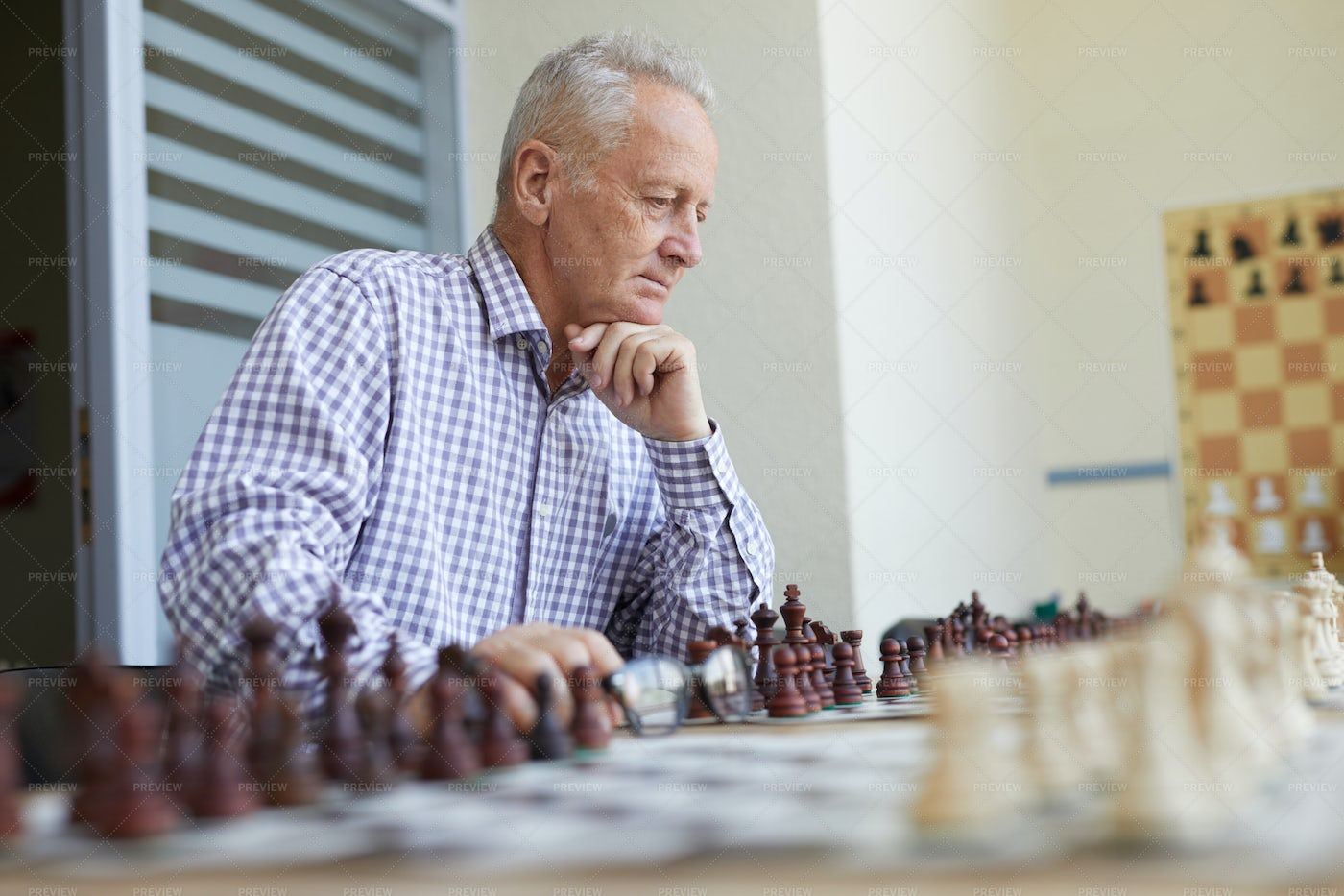 Old Man Playing Chess: Stock Photos