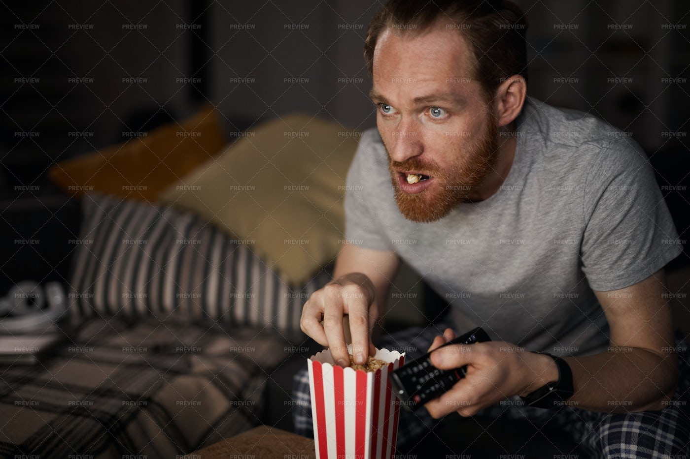 Adult Man Watching Moview At Night: Stock Photos