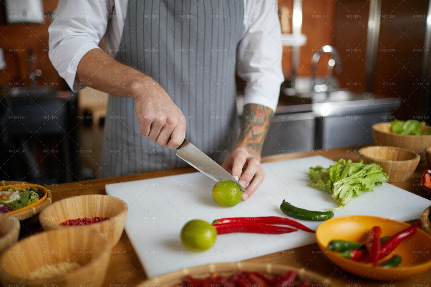 Chef Cutting Citrus In Kitchen: Stock Photos