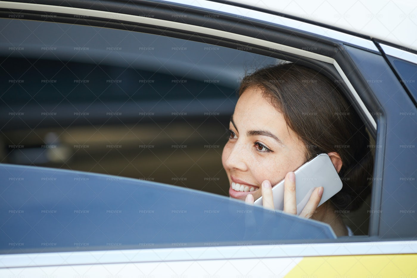 Smiling Woman Speaking By Phone In...: Stock Photos