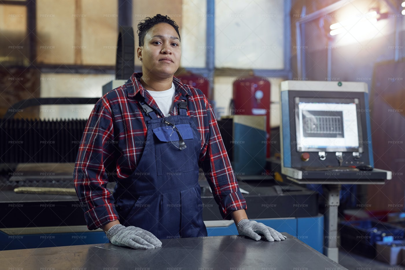 Contemporary Female Worker At Plant: Stock Photos