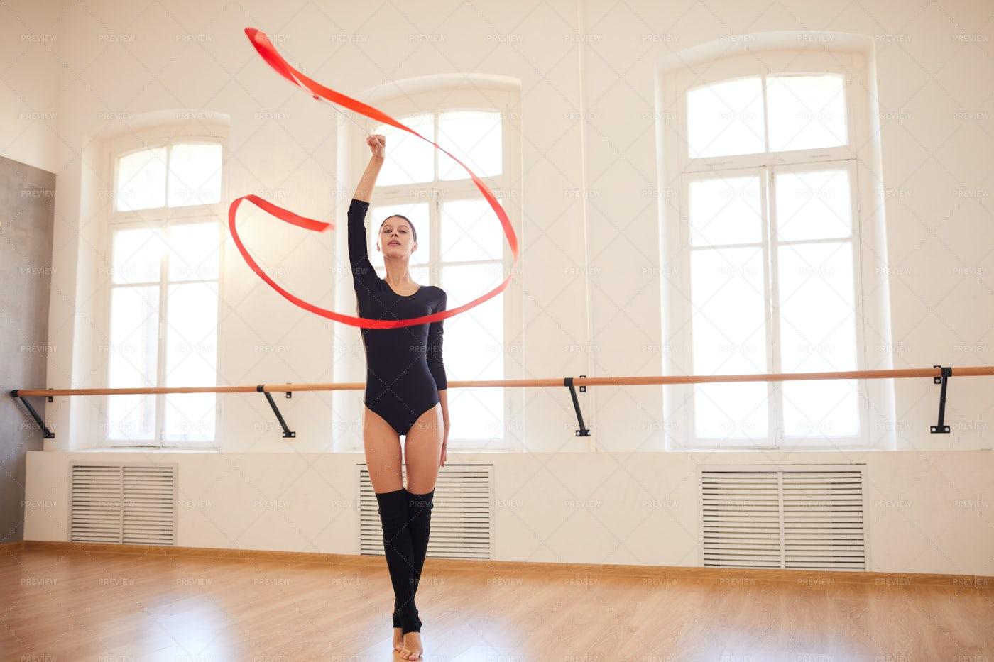 Elegant Girl Performing Rhythmic...: Stock Photos