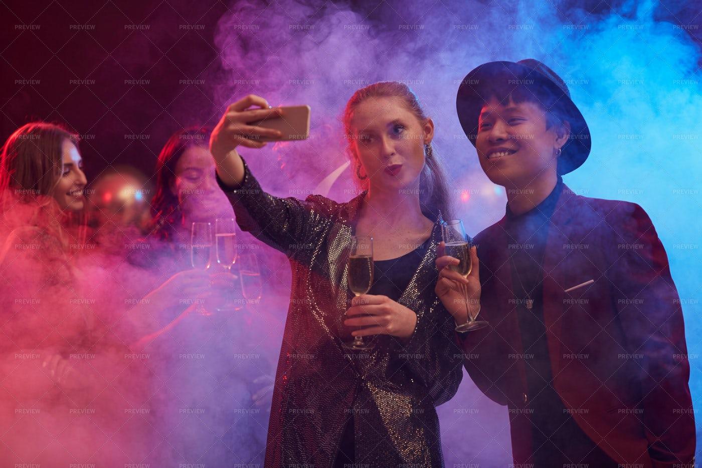 Couple Taking Selfie In Nightclub: Stock Photos