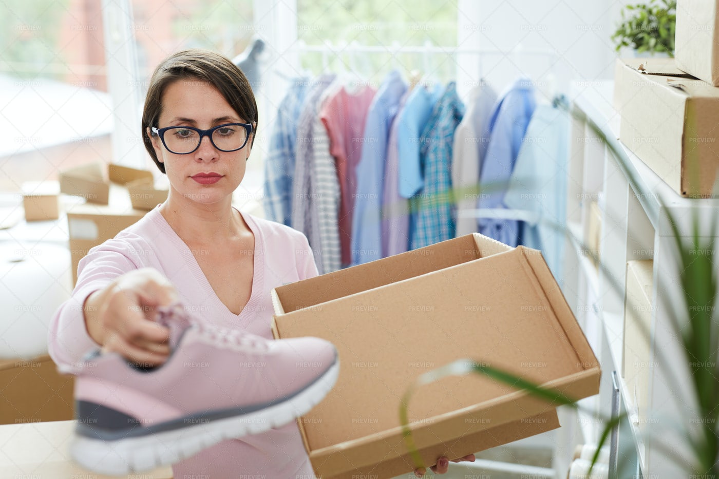 Manager Of Online Footwear Shop...: Stock Photos