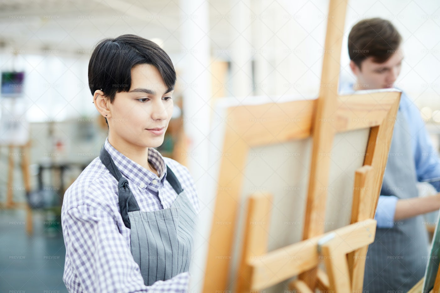 Female Artist Painting On Easel: Stock Photos