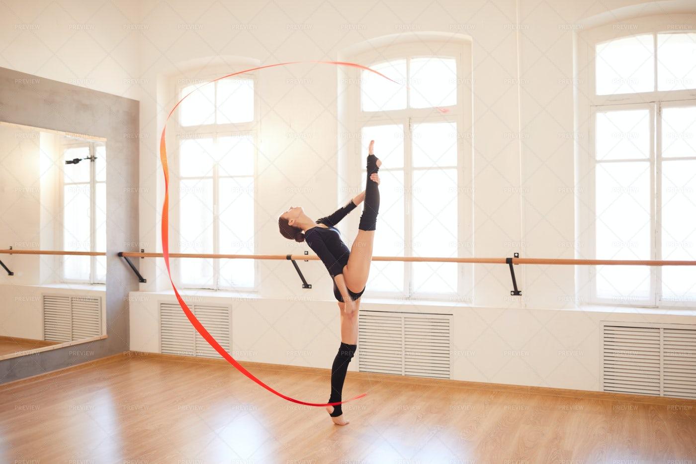Flexible Girl Performing With...: Stock Photos