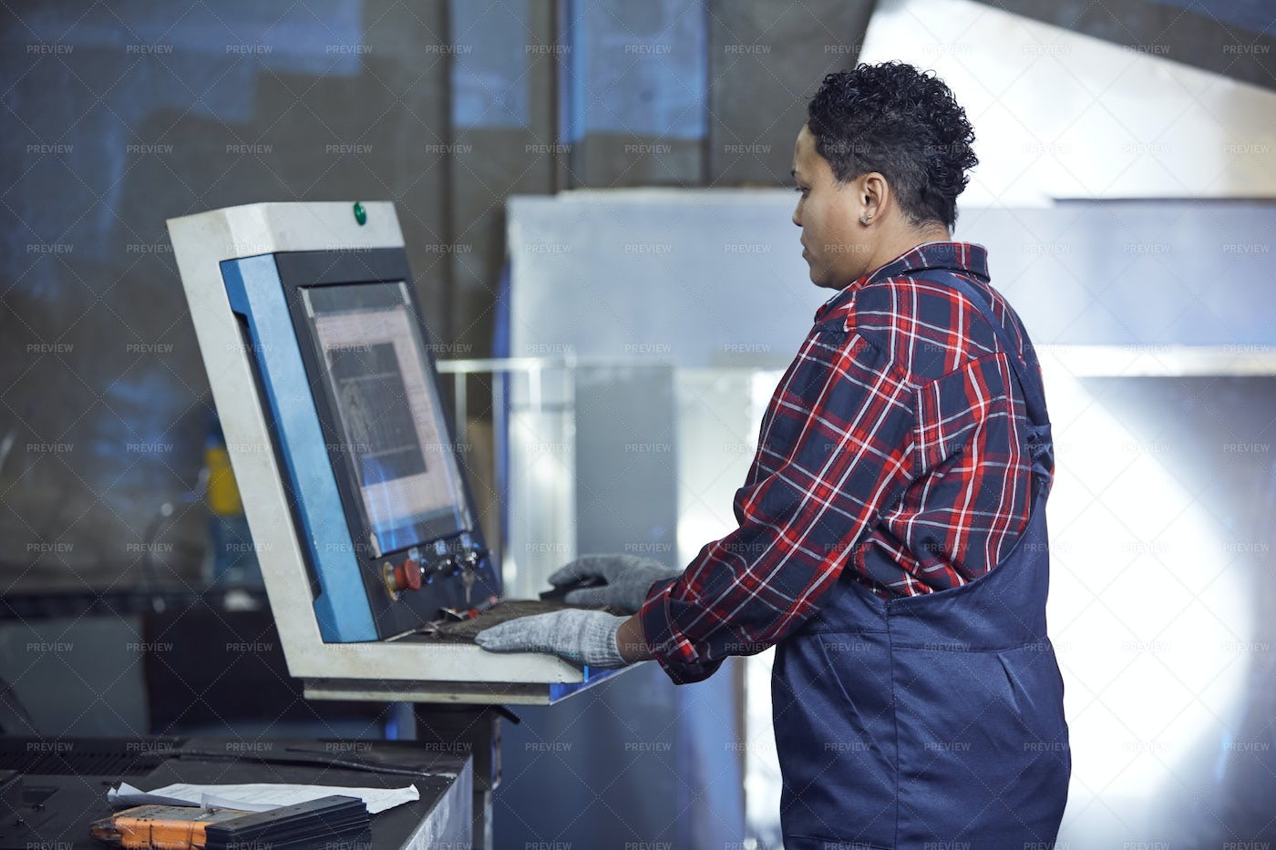 Female Worker Using Machines At...: Stock Photos