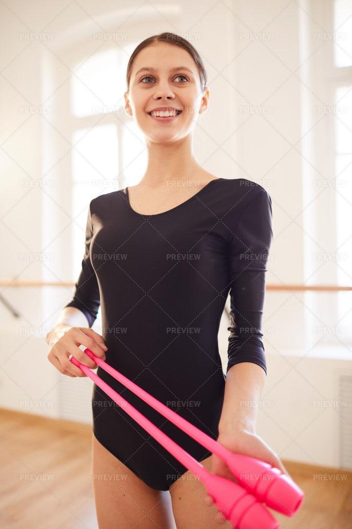Rhythmic Gymnast With Clubs: Stock Photos