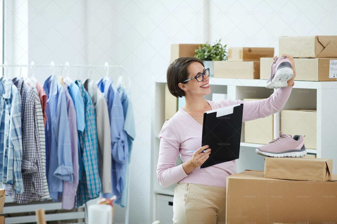 Happy Young Worker Of Online Shop...: Stock Photos