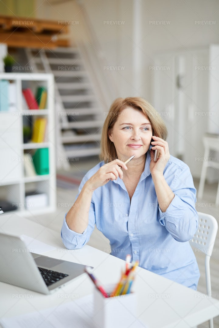 Mature Businesswoman Talking By...: Stock Photos