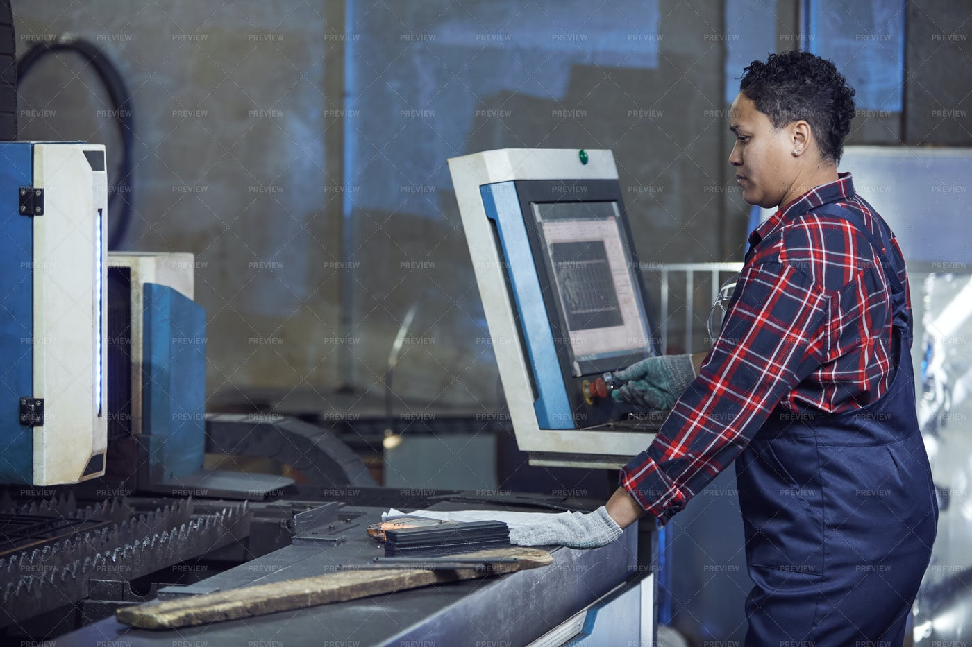 Female Worker Operating Machines In...: Stock Photos