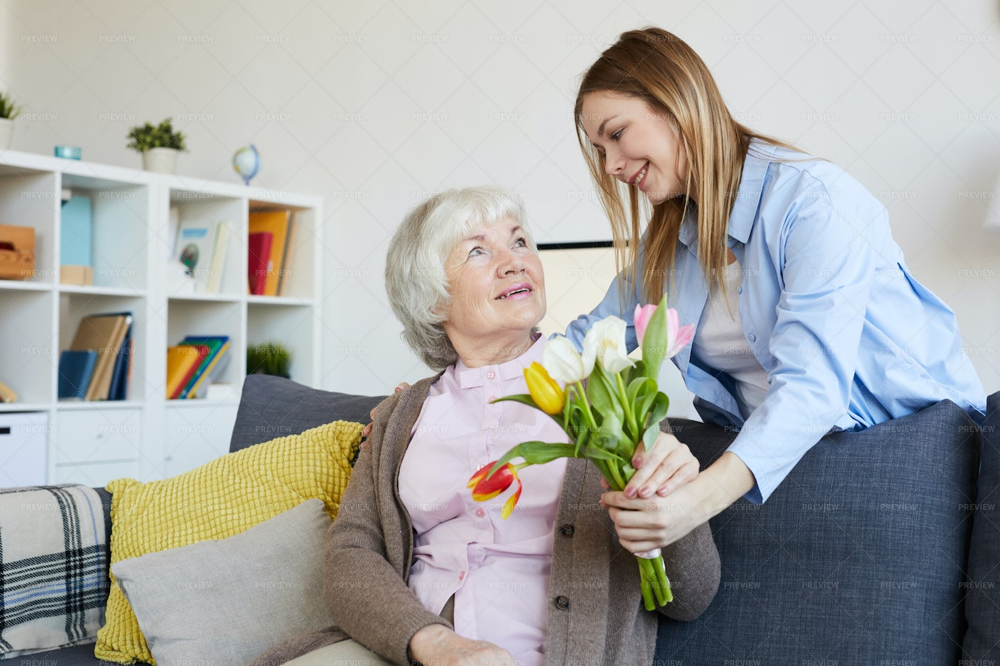Woman Giving Flowers To Mother: Stock Photos
