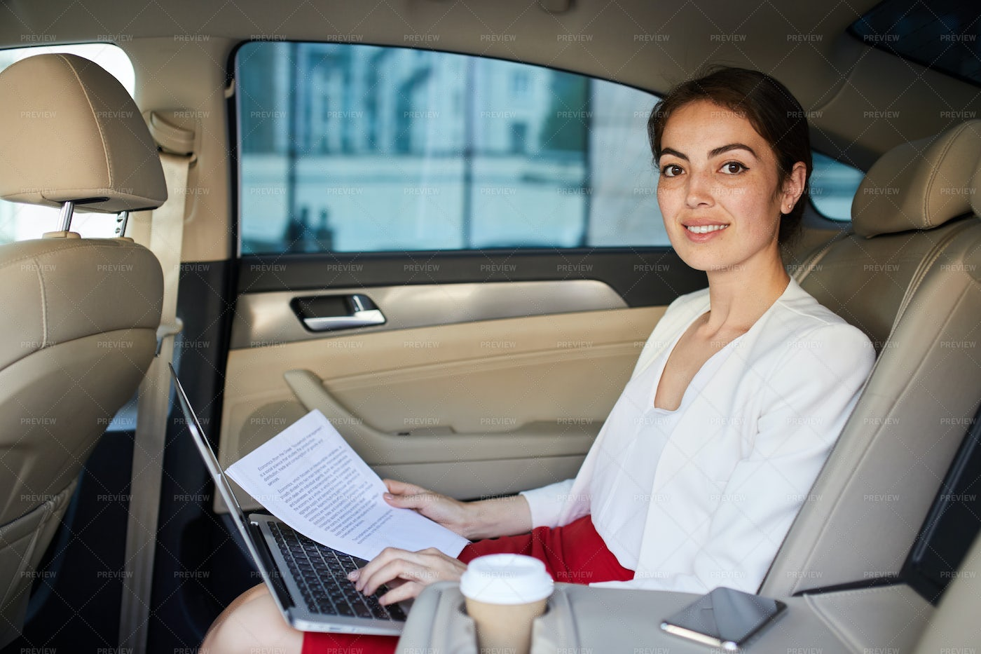 Businesswoman Posing In Taxi: Stock Photos