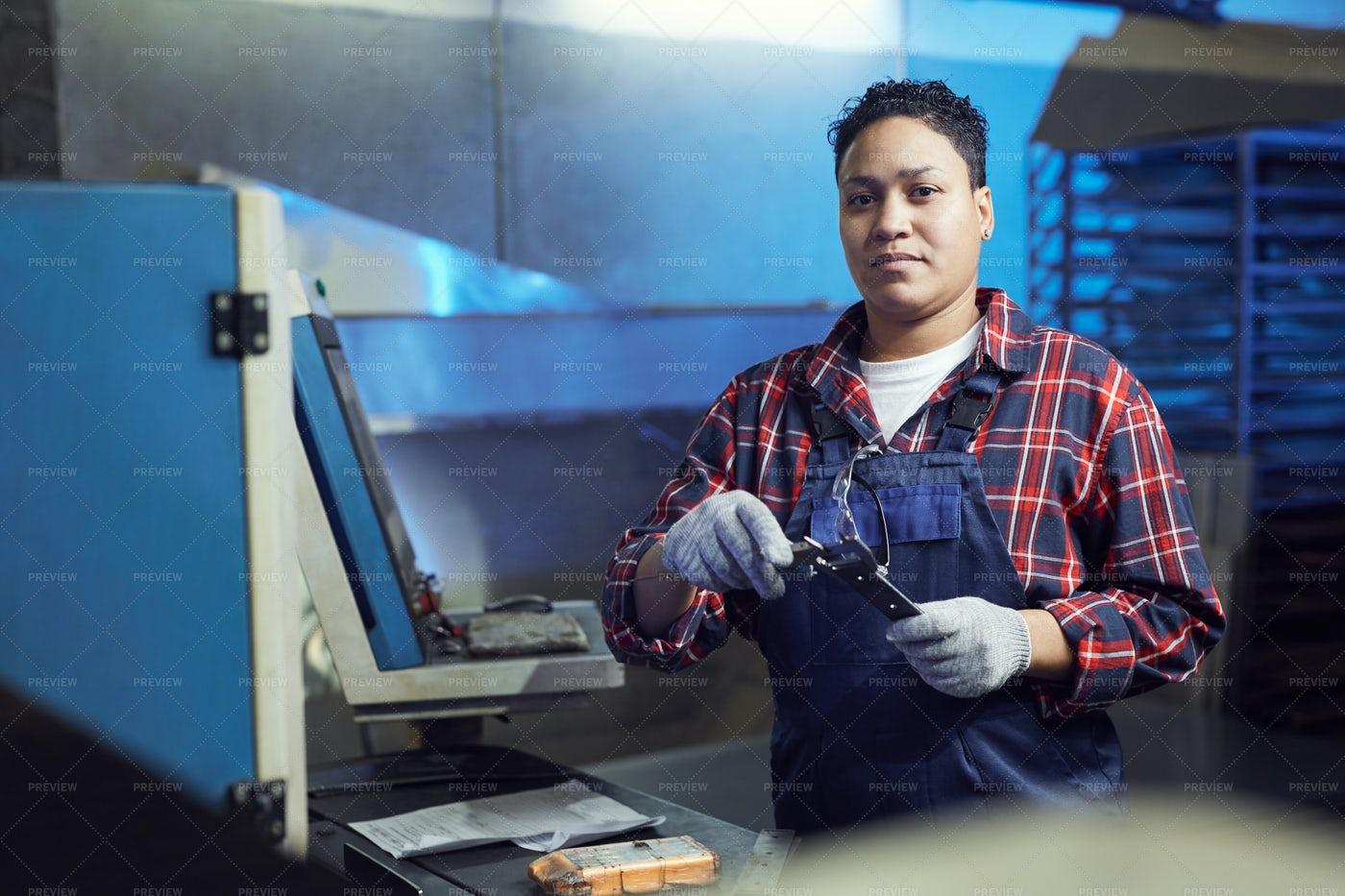 Female Worker Repairing Machines In...: Stock Photos