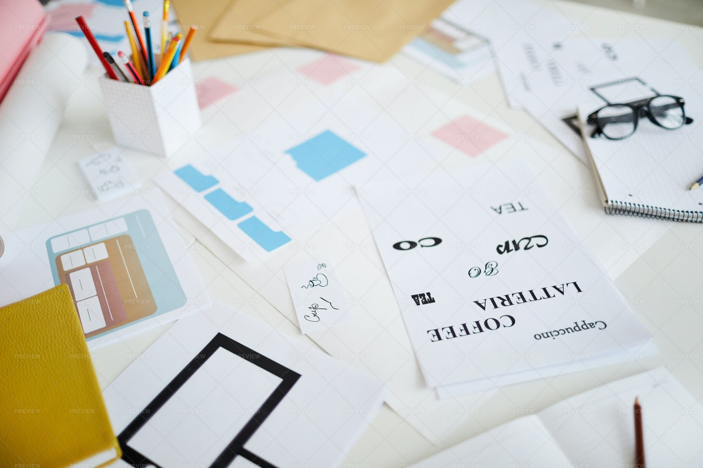 Scattered Designs On Desk: Stock Photos