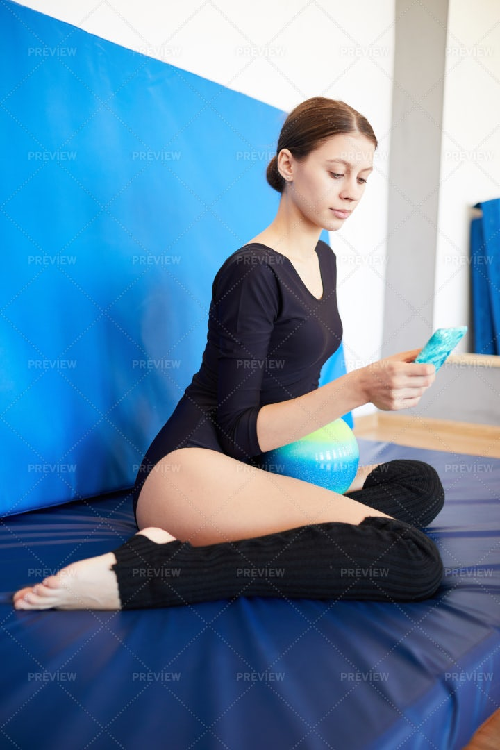Teenage Gymnast Resting After...: Stock Photos