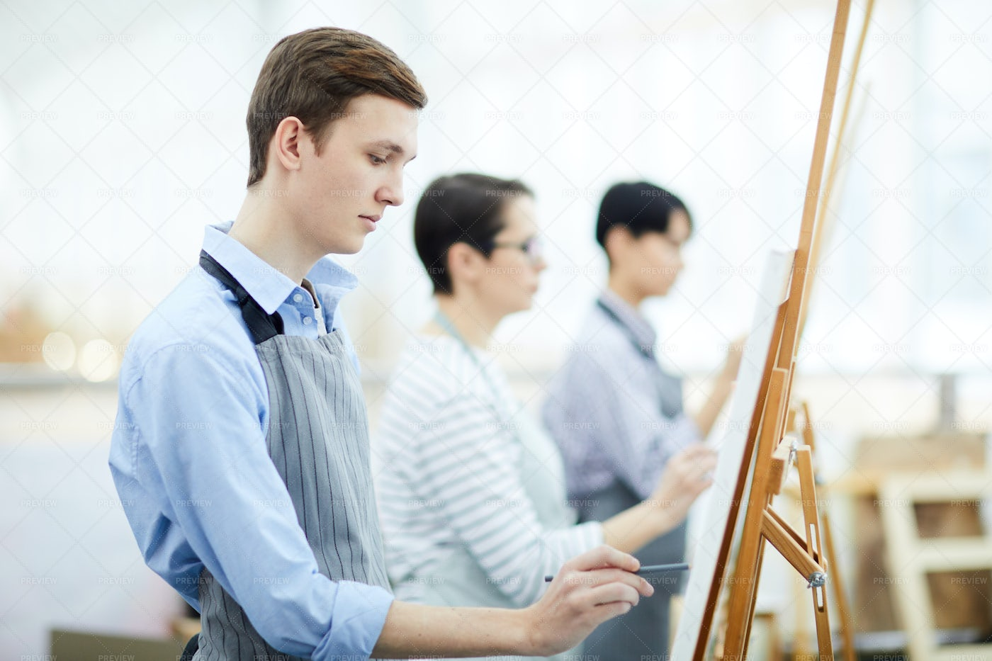 Pensive Young Man Painting: Stock Photos