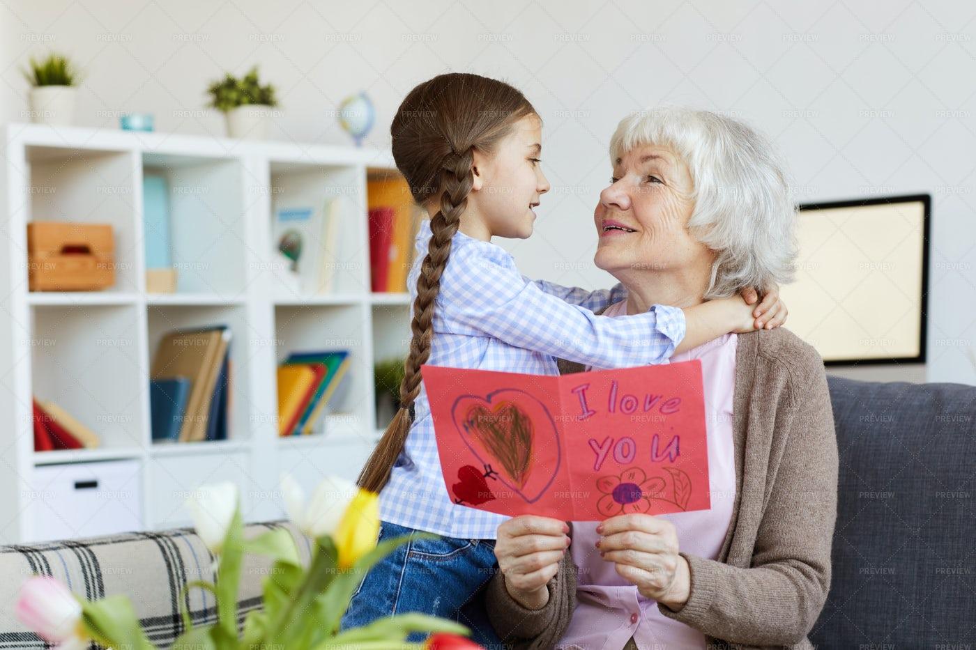 Senior Woman Embracing Cute Girl: Stock Photos