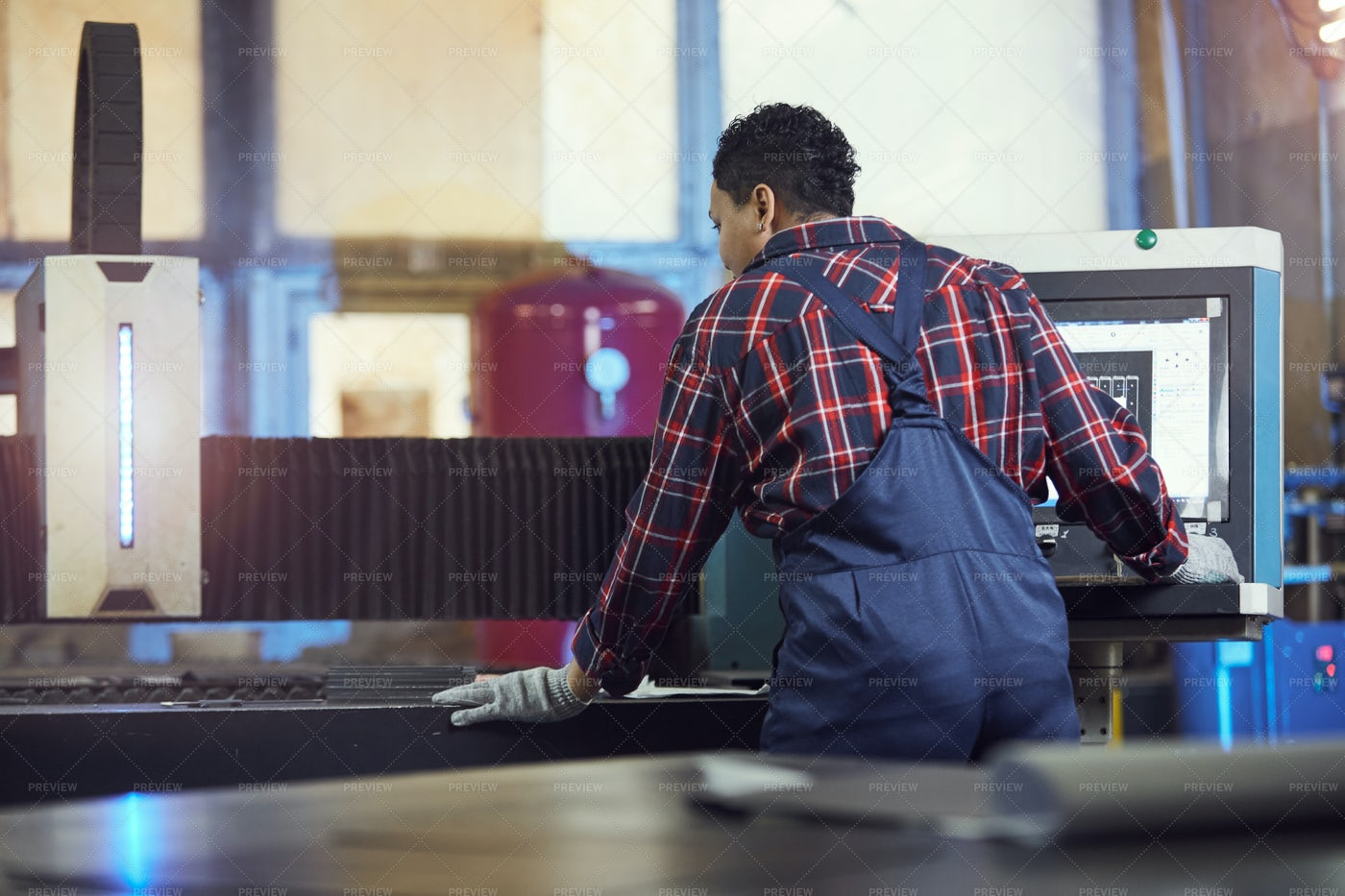 Female Worker Operating Machines At...: Stock Photos