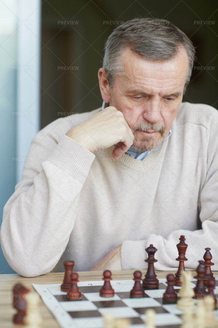 Puzzled Old Grandmaster: Stock Photos