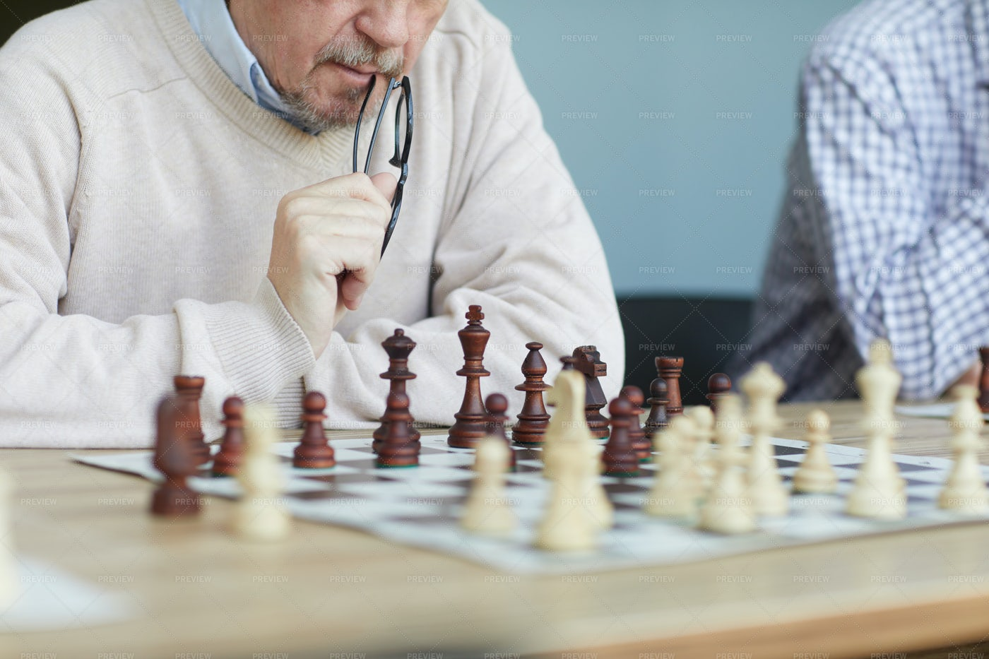 Focused Experienced Chess Player: Stock Photos