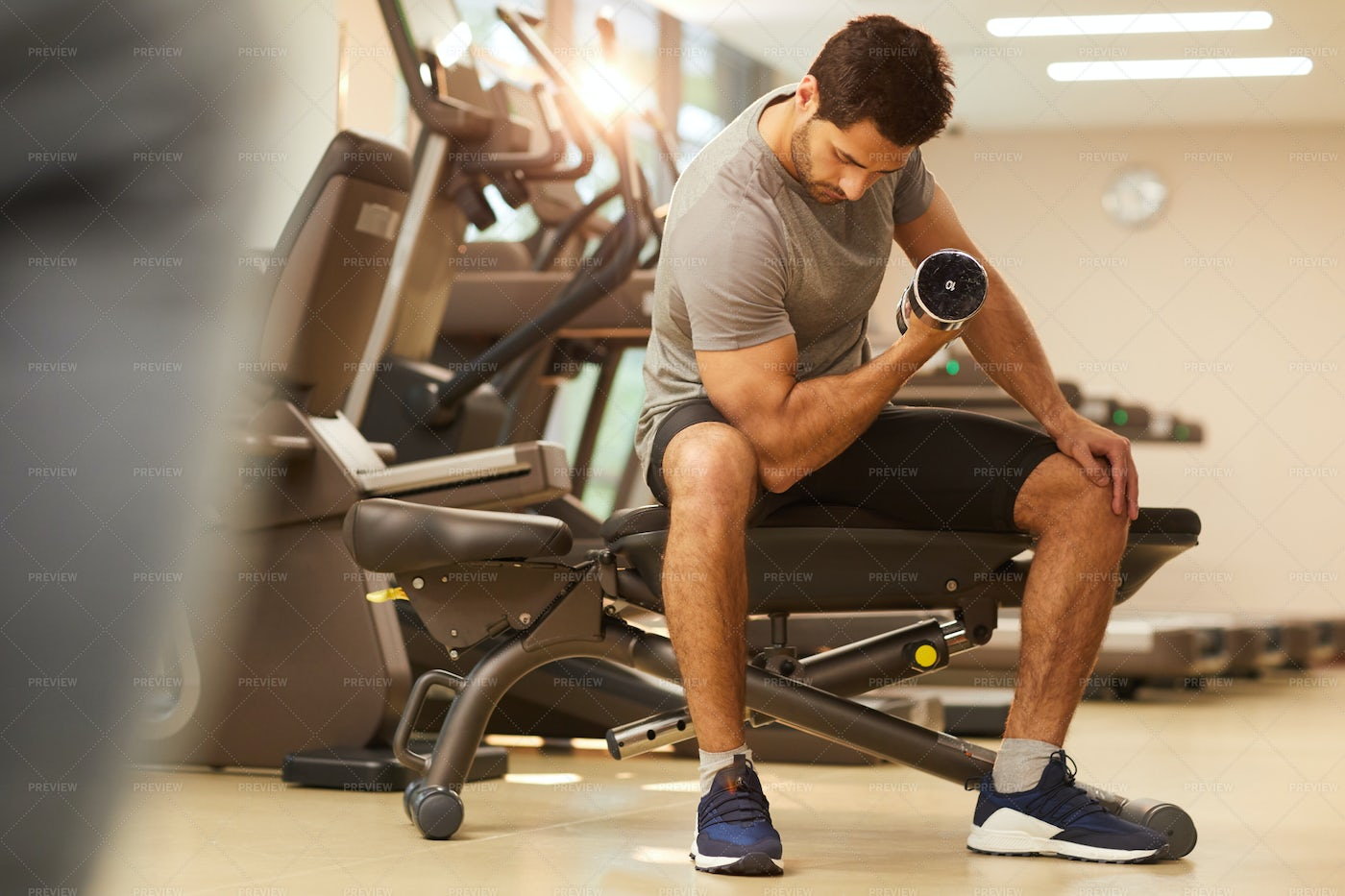 Man Pumping Muscles In Gym: Stock Photos