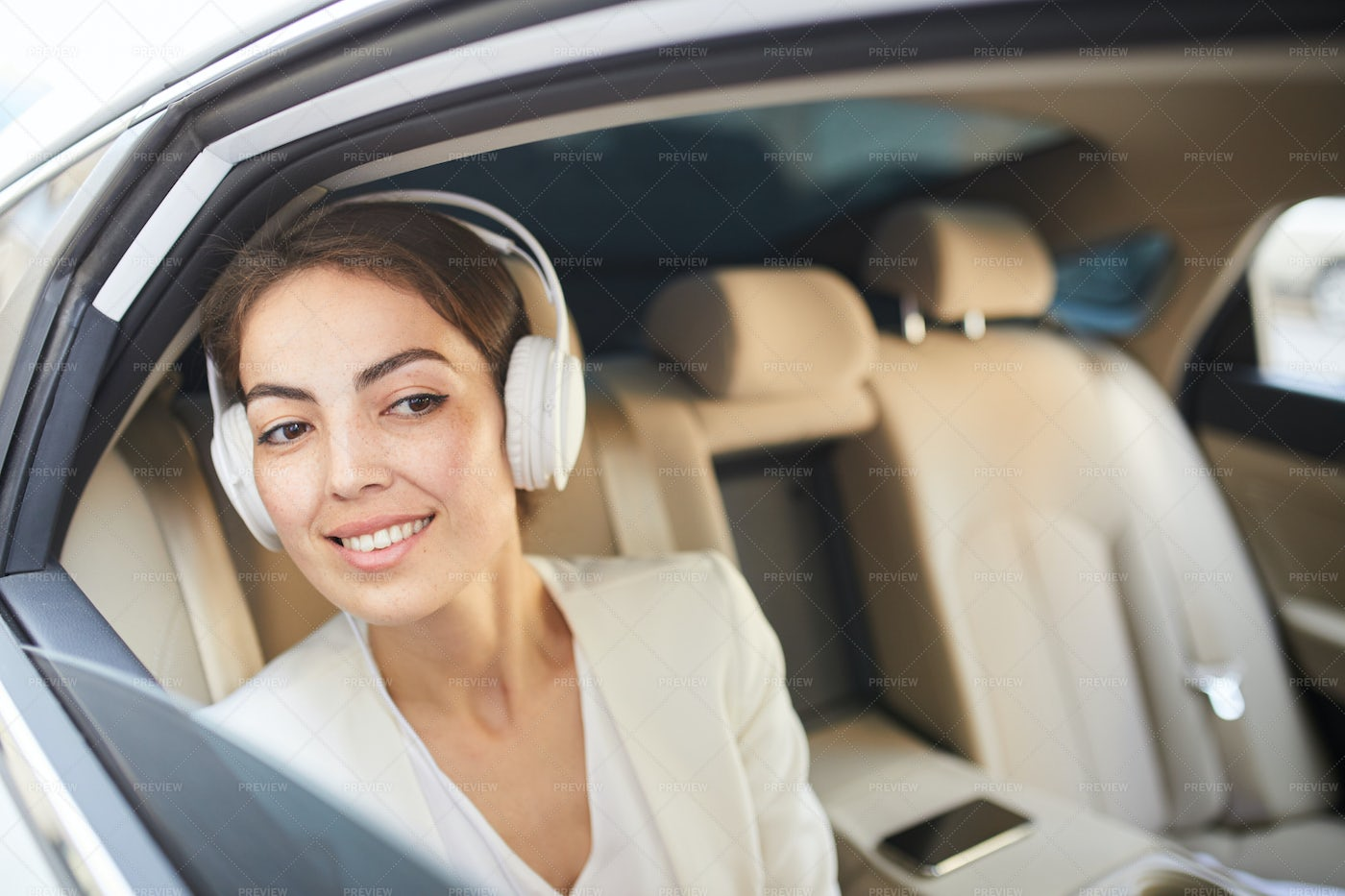Smiling Woman Listening To Music In...: Stock Photos