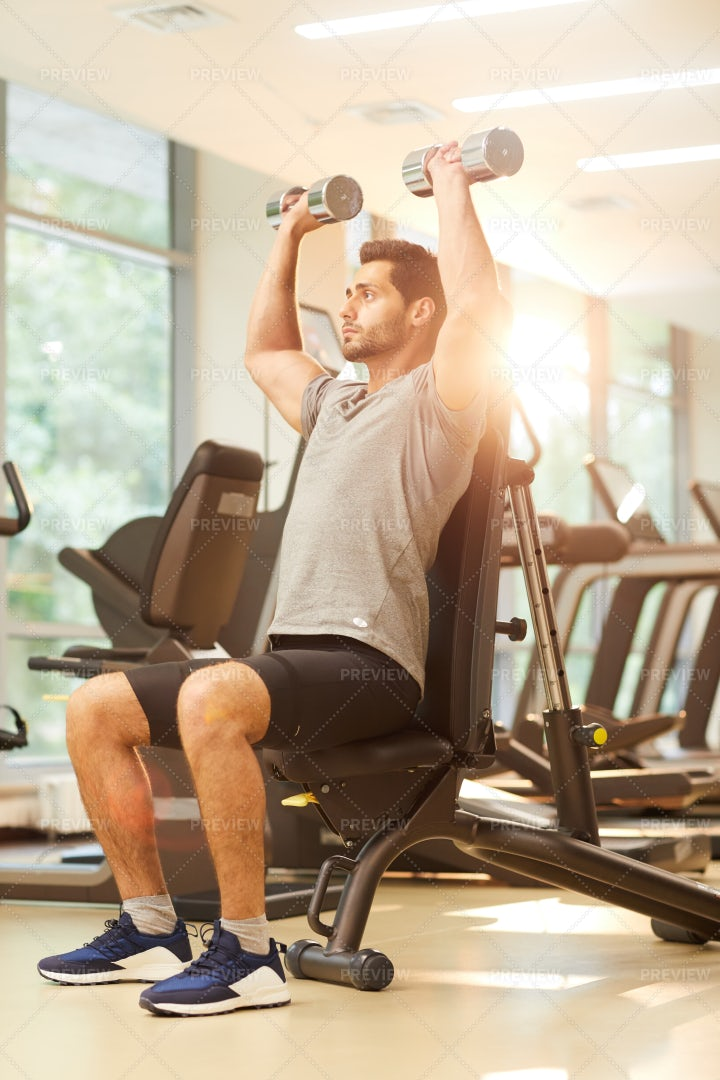 Man Training On Machines In Gym: Stock Photos