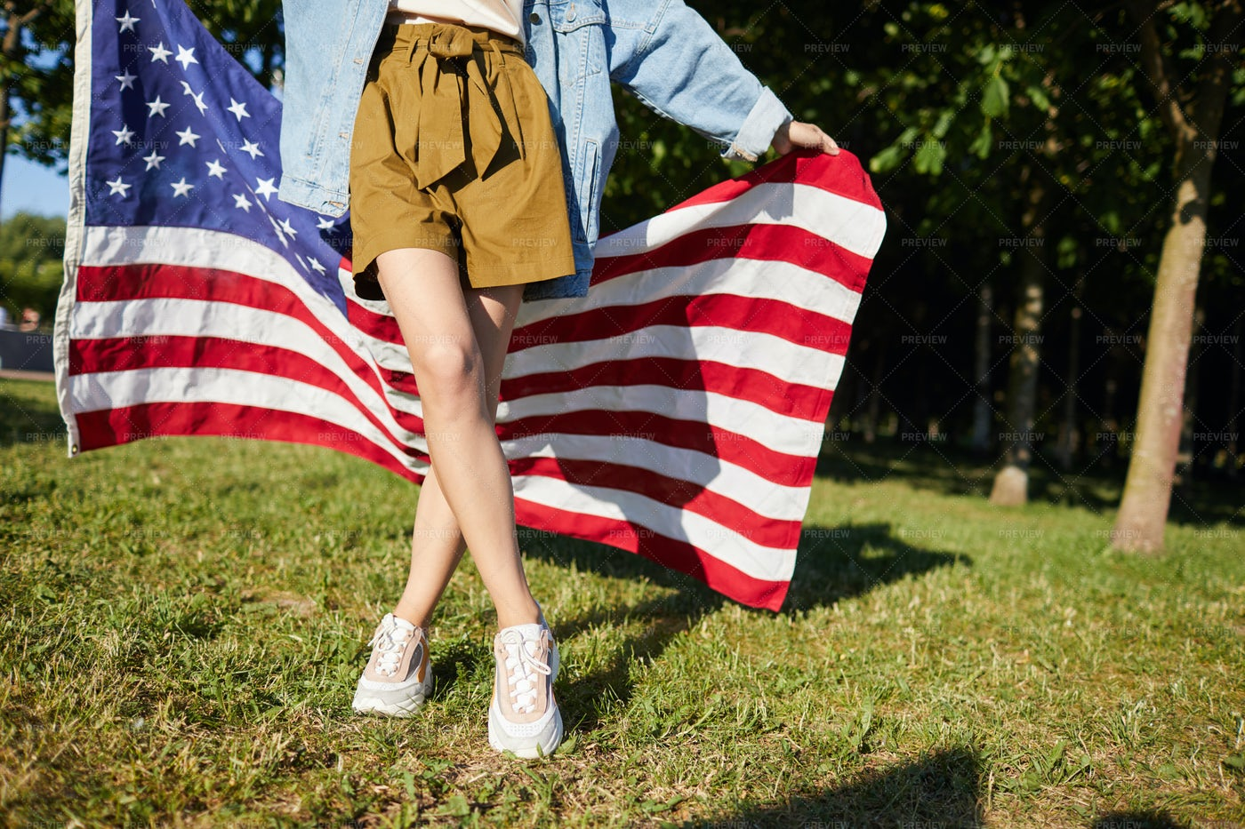 Walking With American Flag: Stock Photos