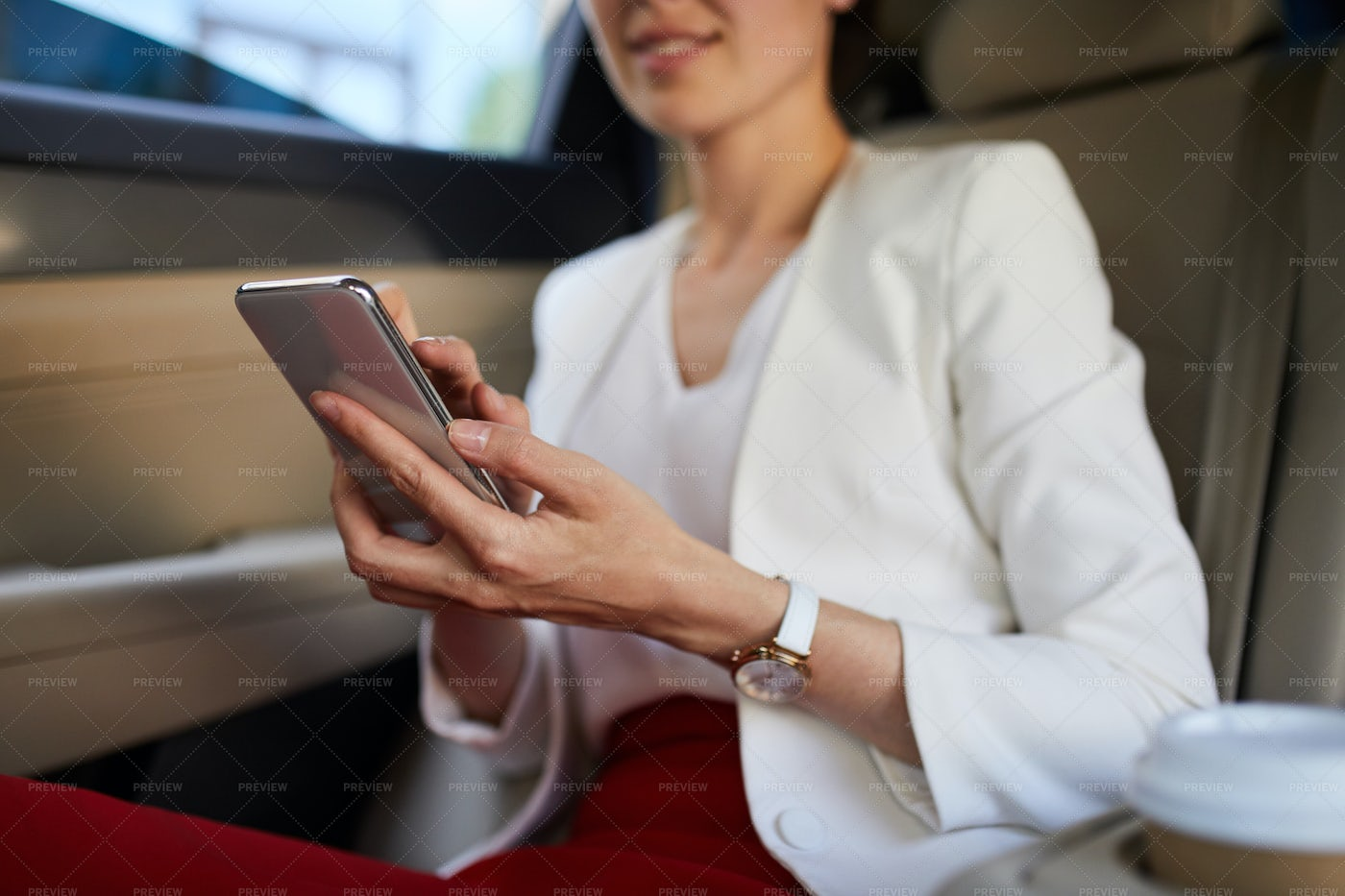 Woman Using Smartphone In Car: Stock Photos