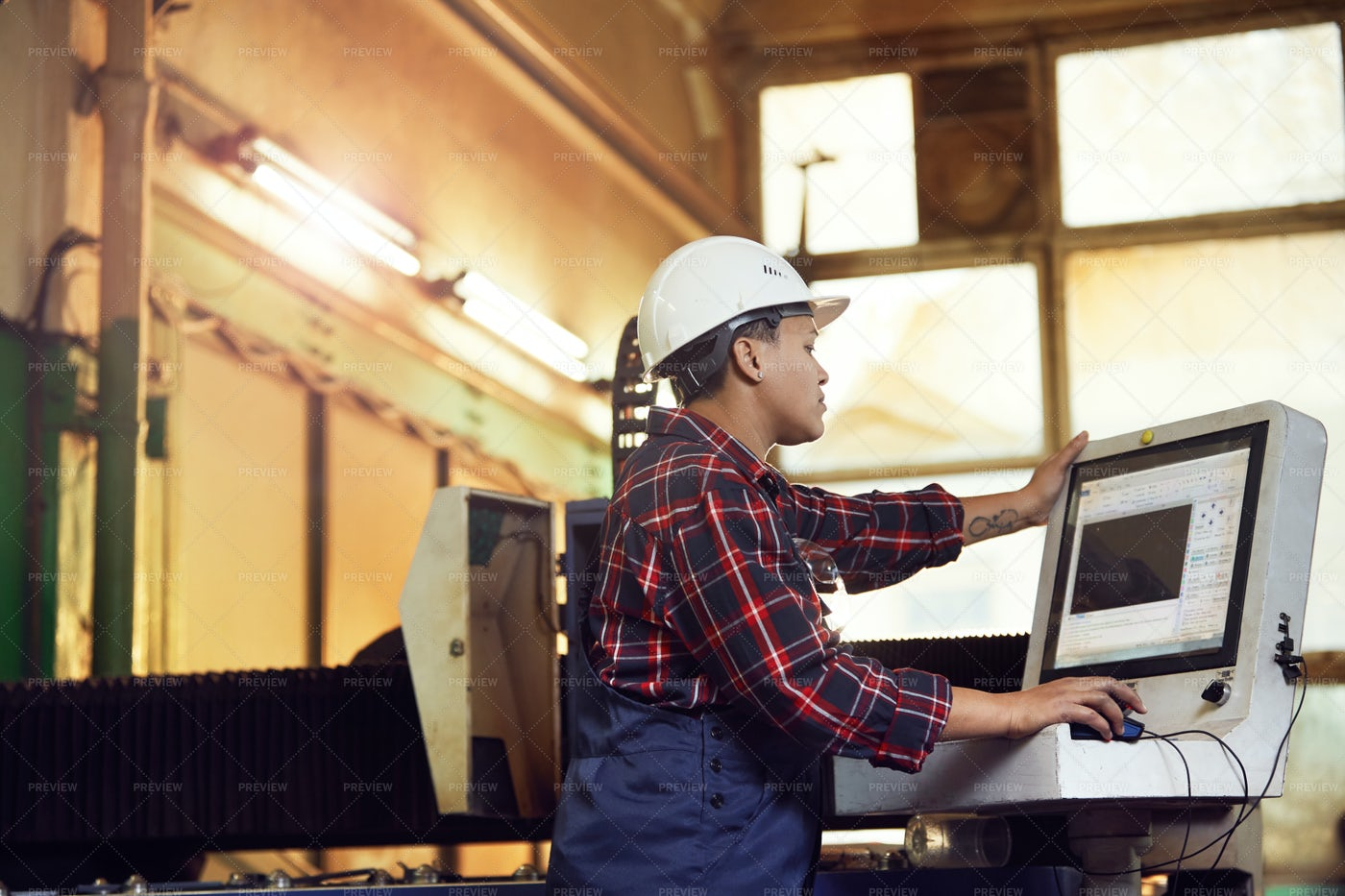 Side View Portrait Of Female Worker...: Stock Photos