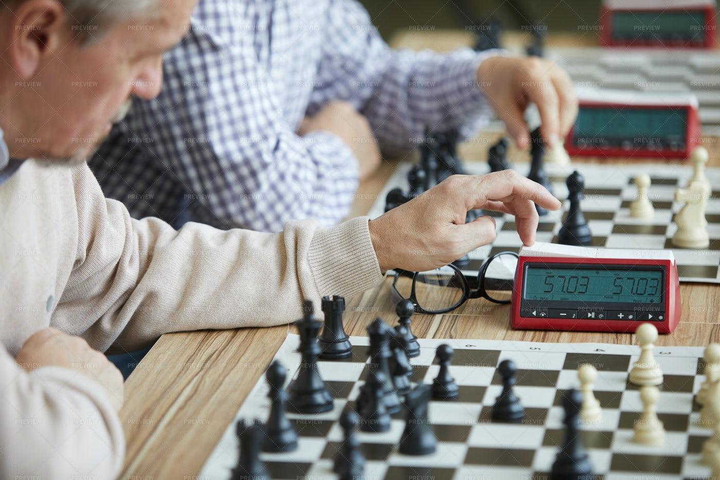 Careful Pressing Chess Clock: Stock Photos