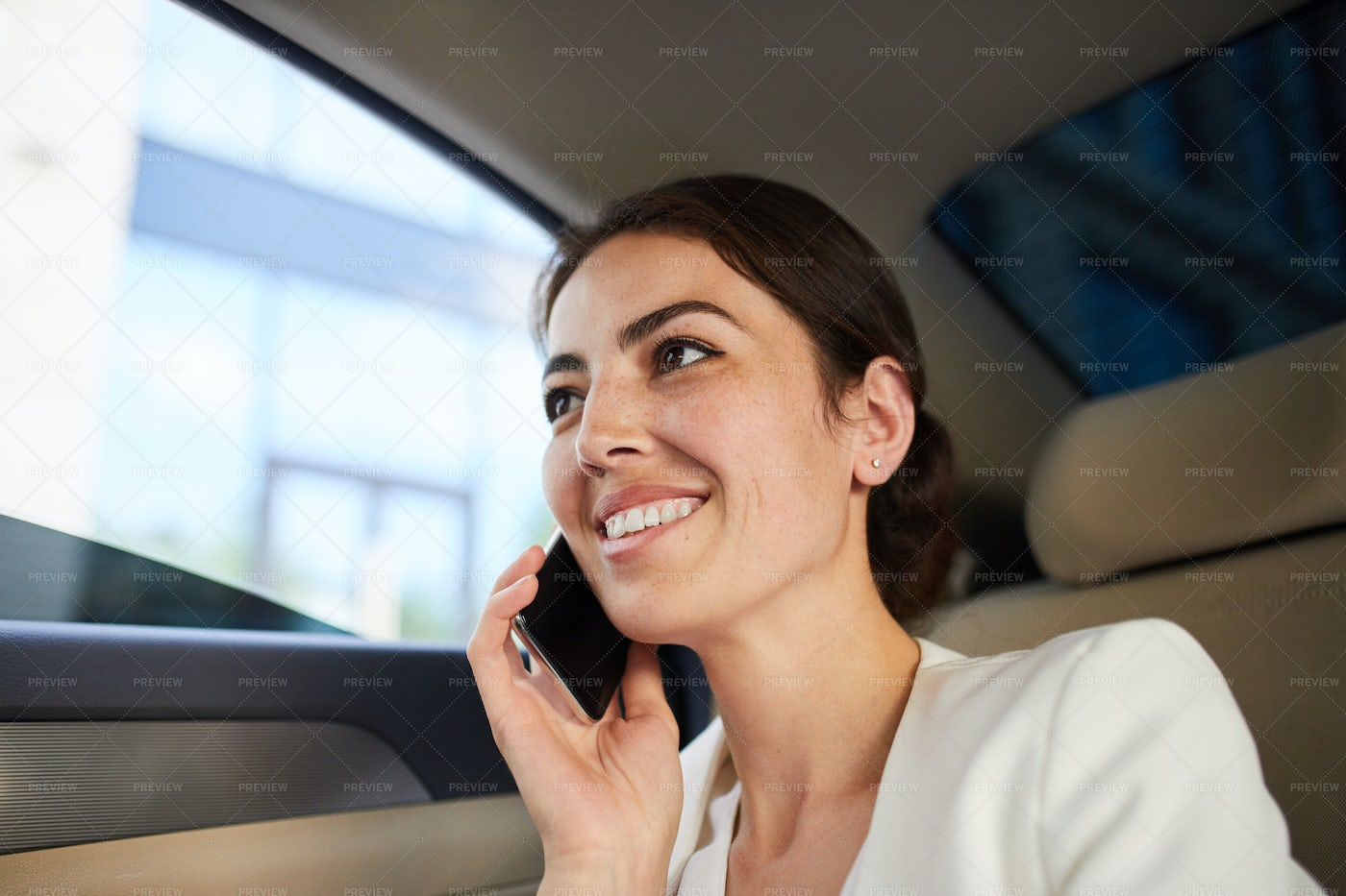 Woman Speaking By Smartphone In Car: Stock Photos