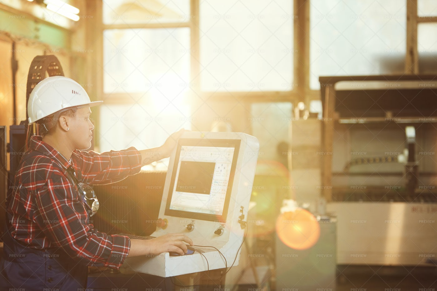 Female Worker Operating Electronic...: Stock Photos