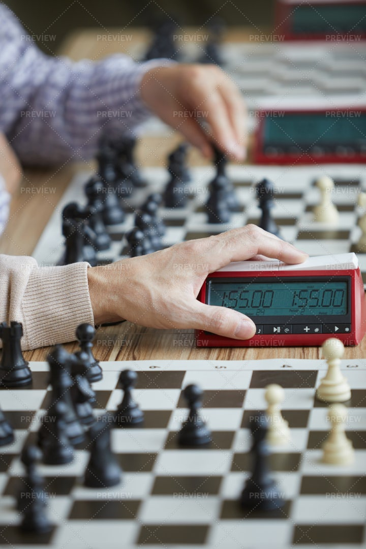 Hand Pressing Chess Clock: Stock Photos