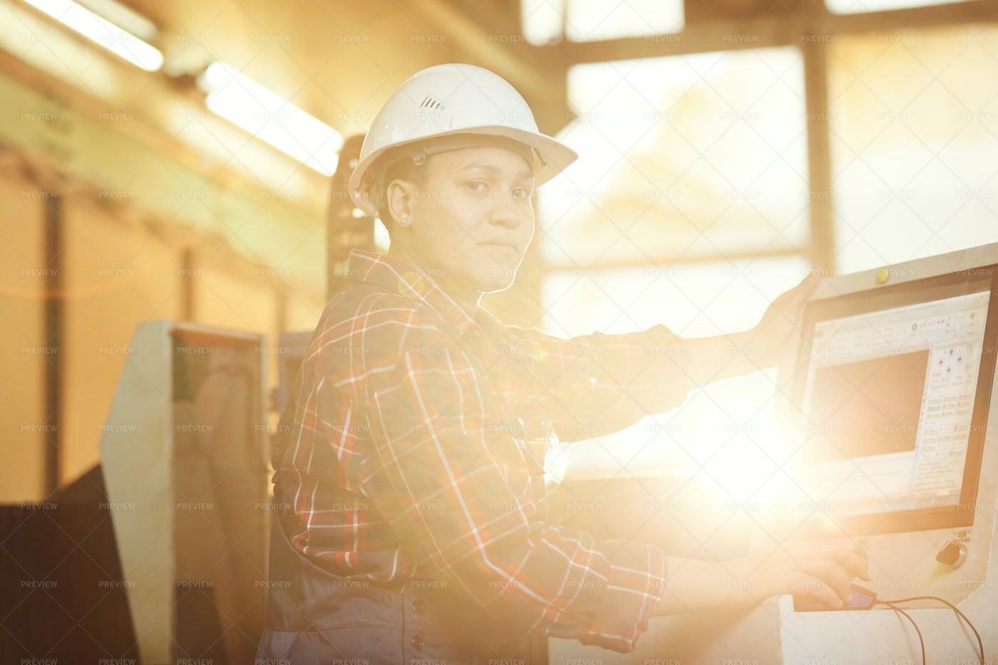 Portrait Of Female Worker Operating...: Stock Photos