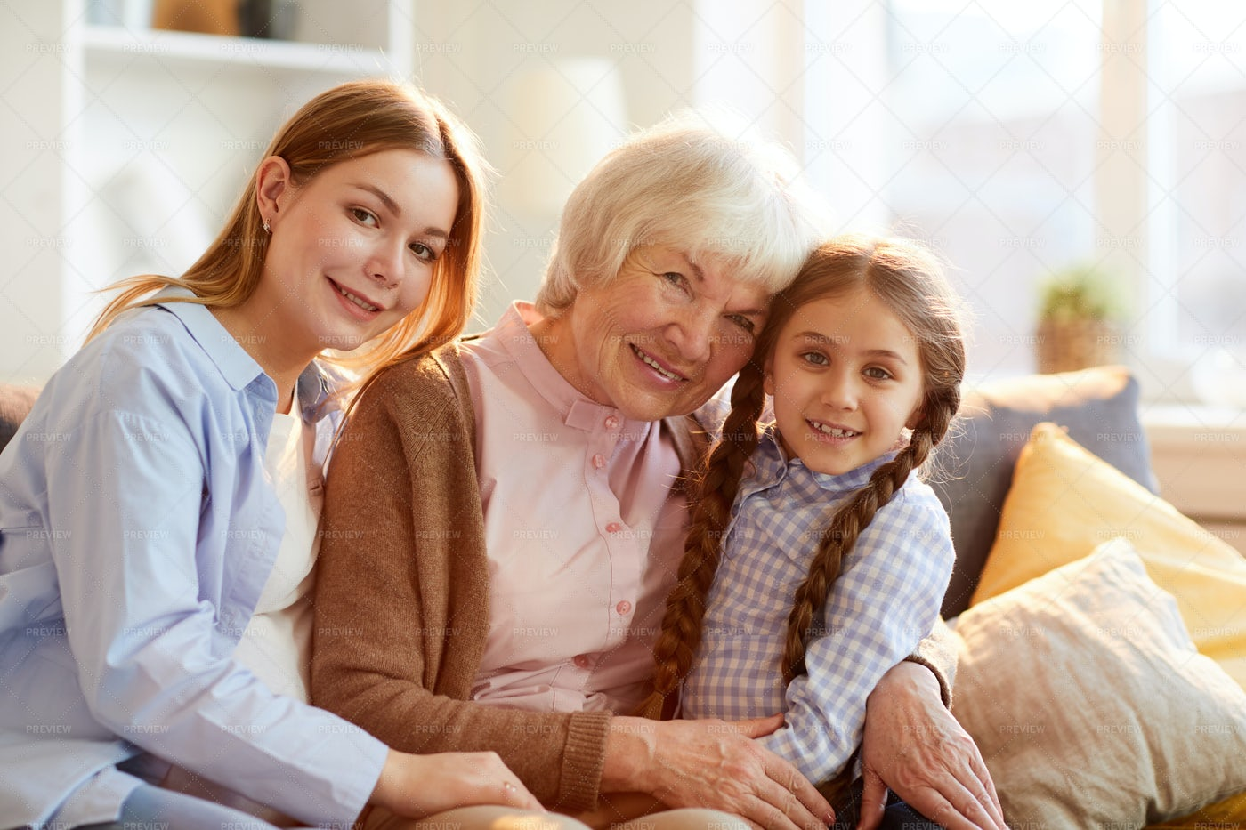 Grandmother Posing With Family: Stock Photos