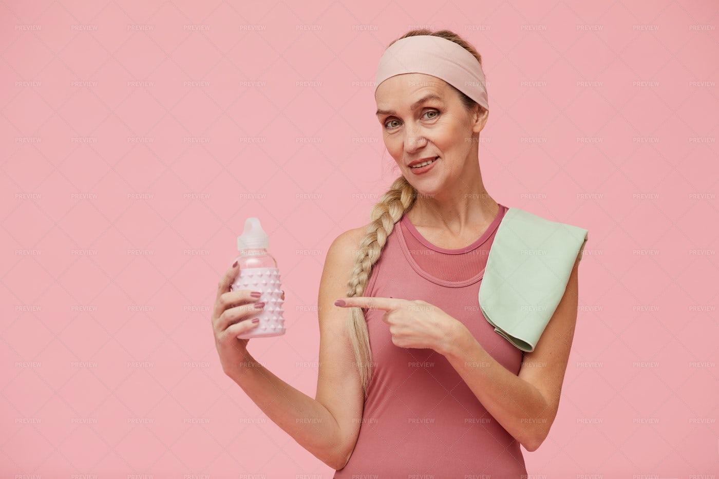 Sportive Matre Woman Holding Water...: Stock Photos