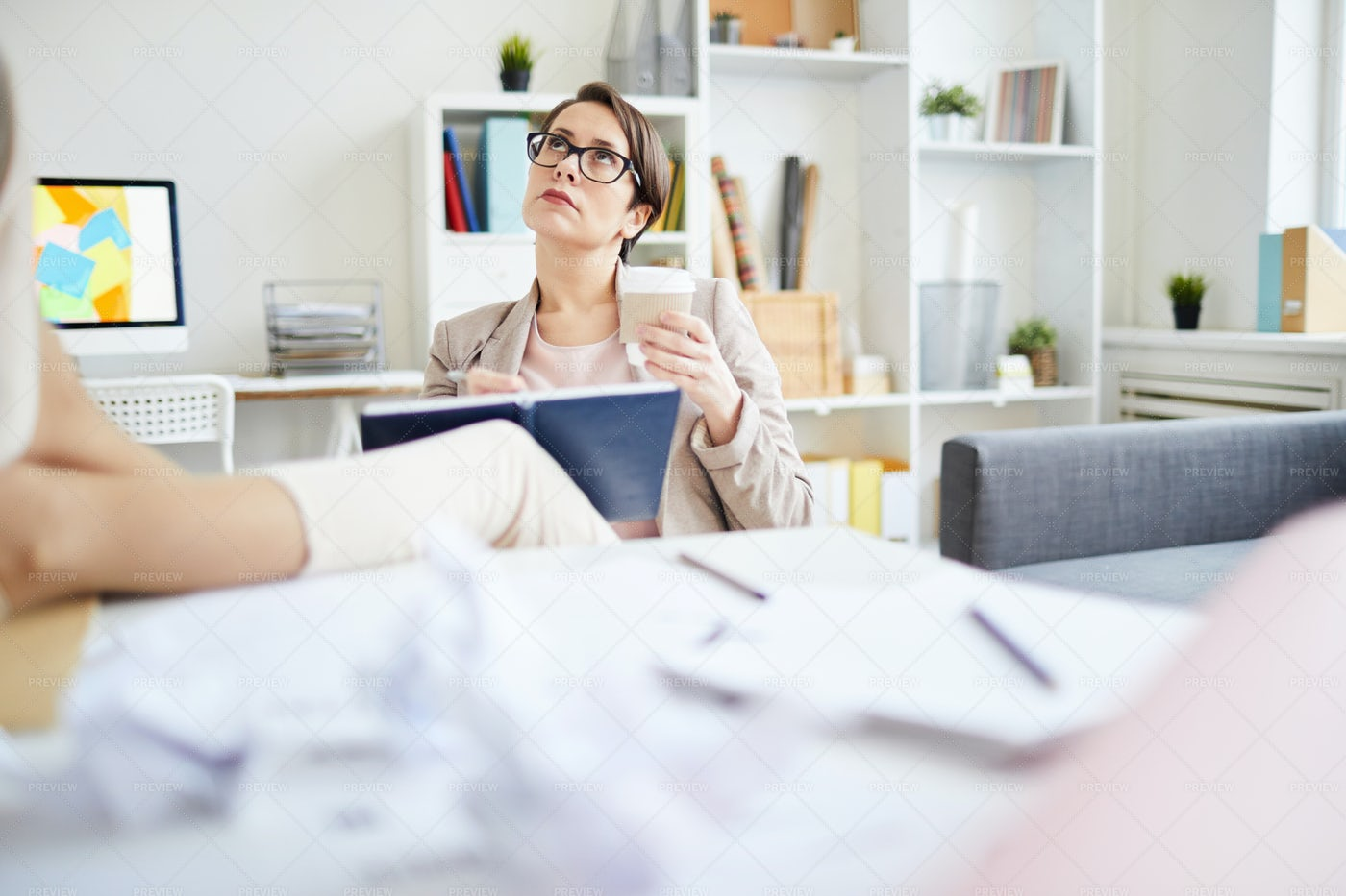 Businesswoman Writing In Journal: Stock Photos
