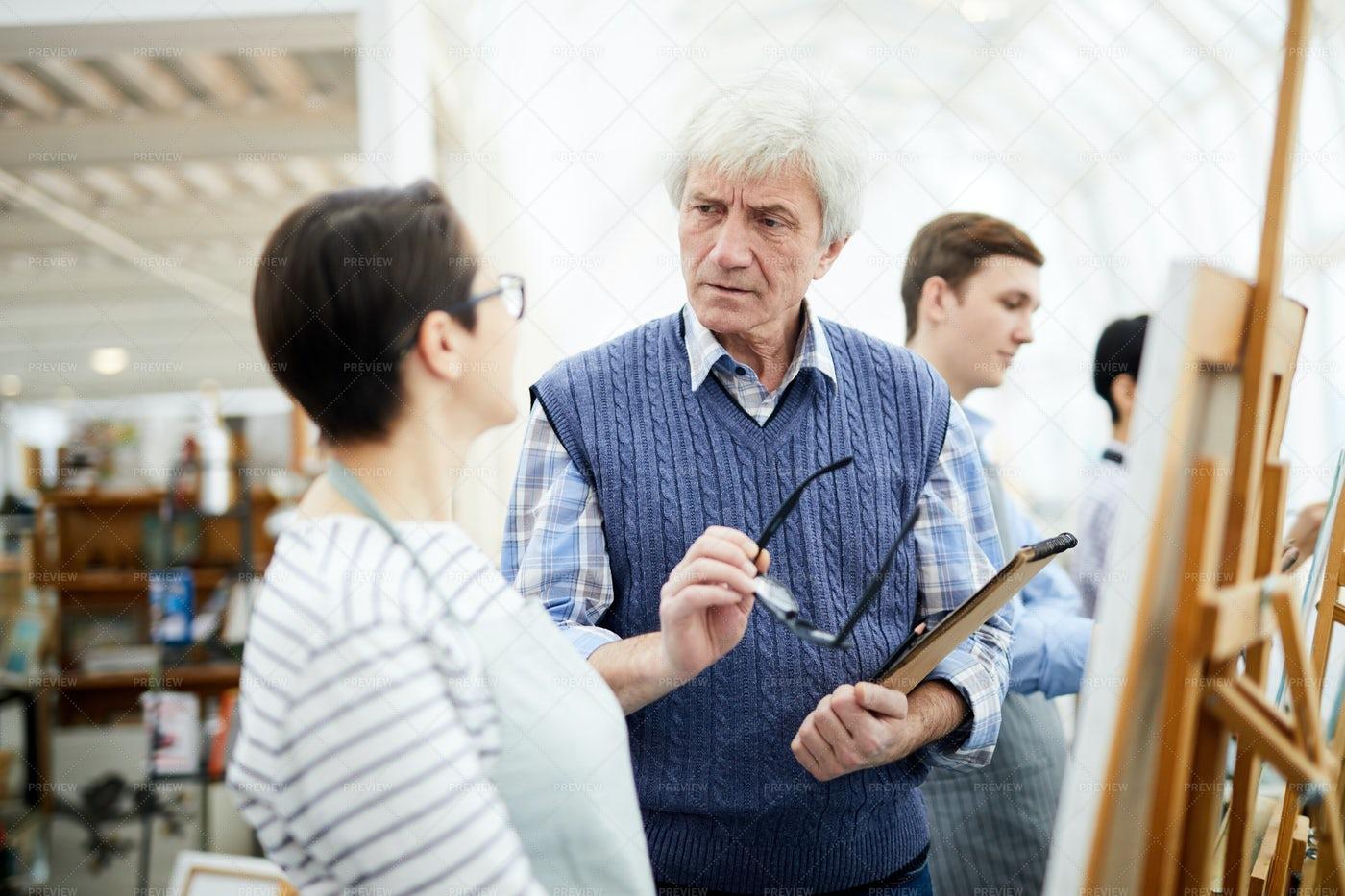 Senior Art Teacher Talking To...: Stock Photos