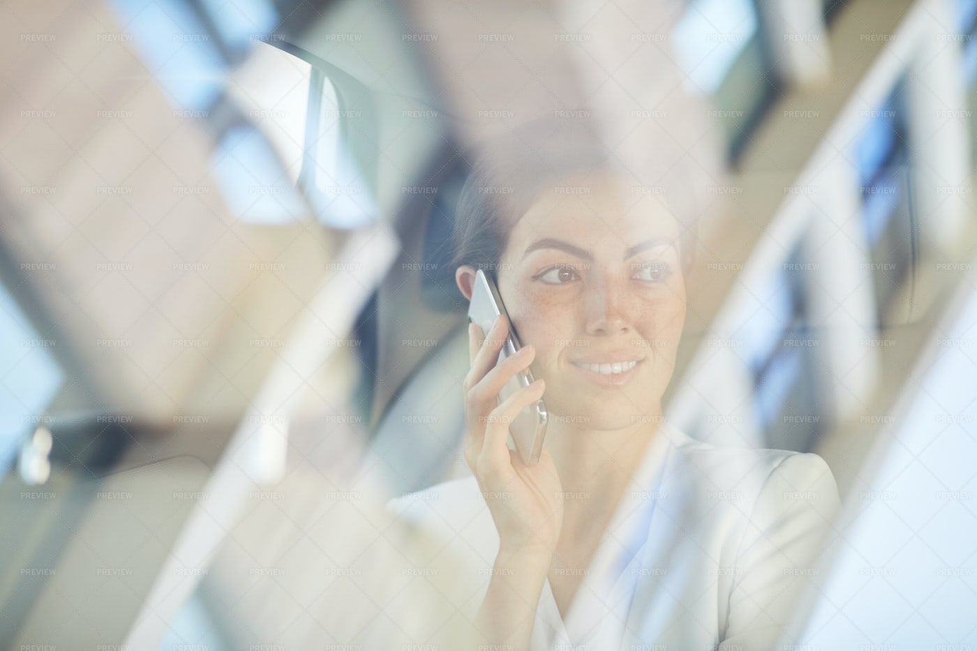 Woman Speaking By Phone On Taxi...: Stock Photos
