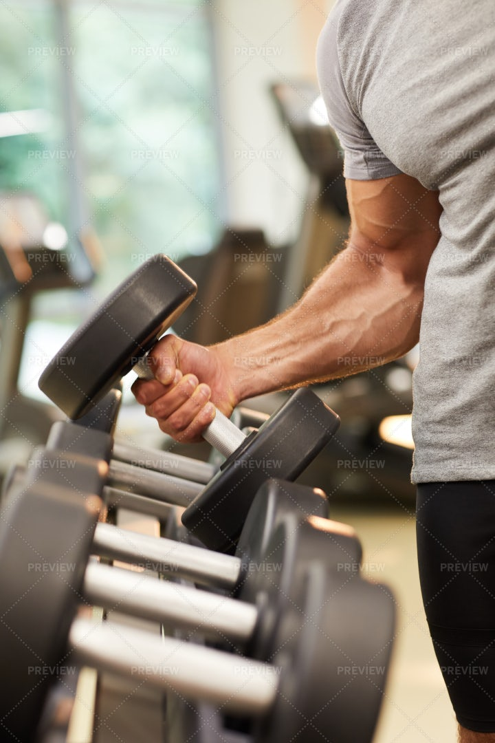 Strong Man Holding Dumbbell: Stock Photos