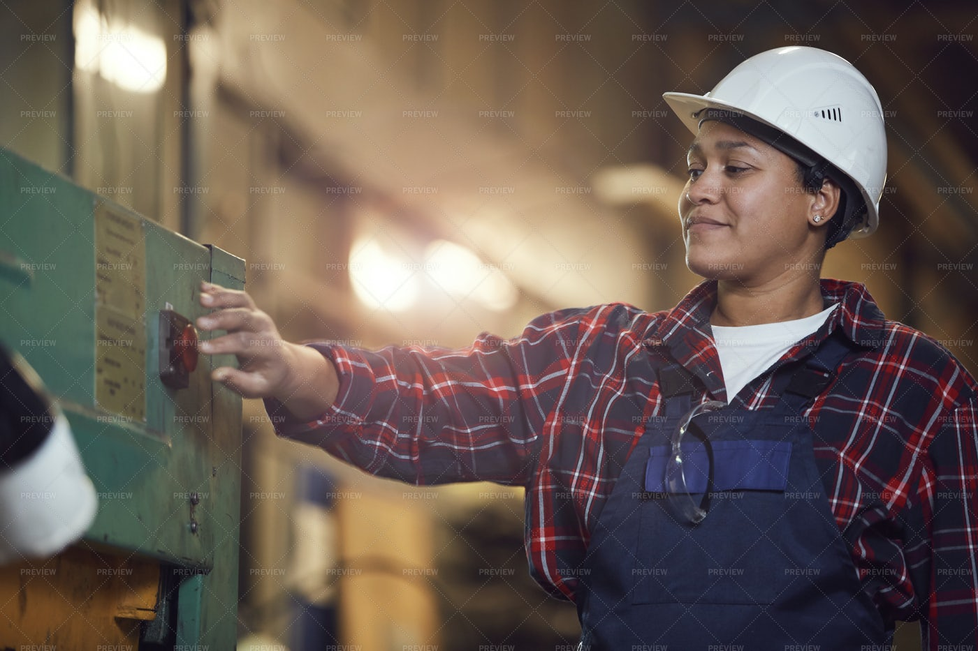 Mixed-Race Female Worker Pressing...: Stock Photos
