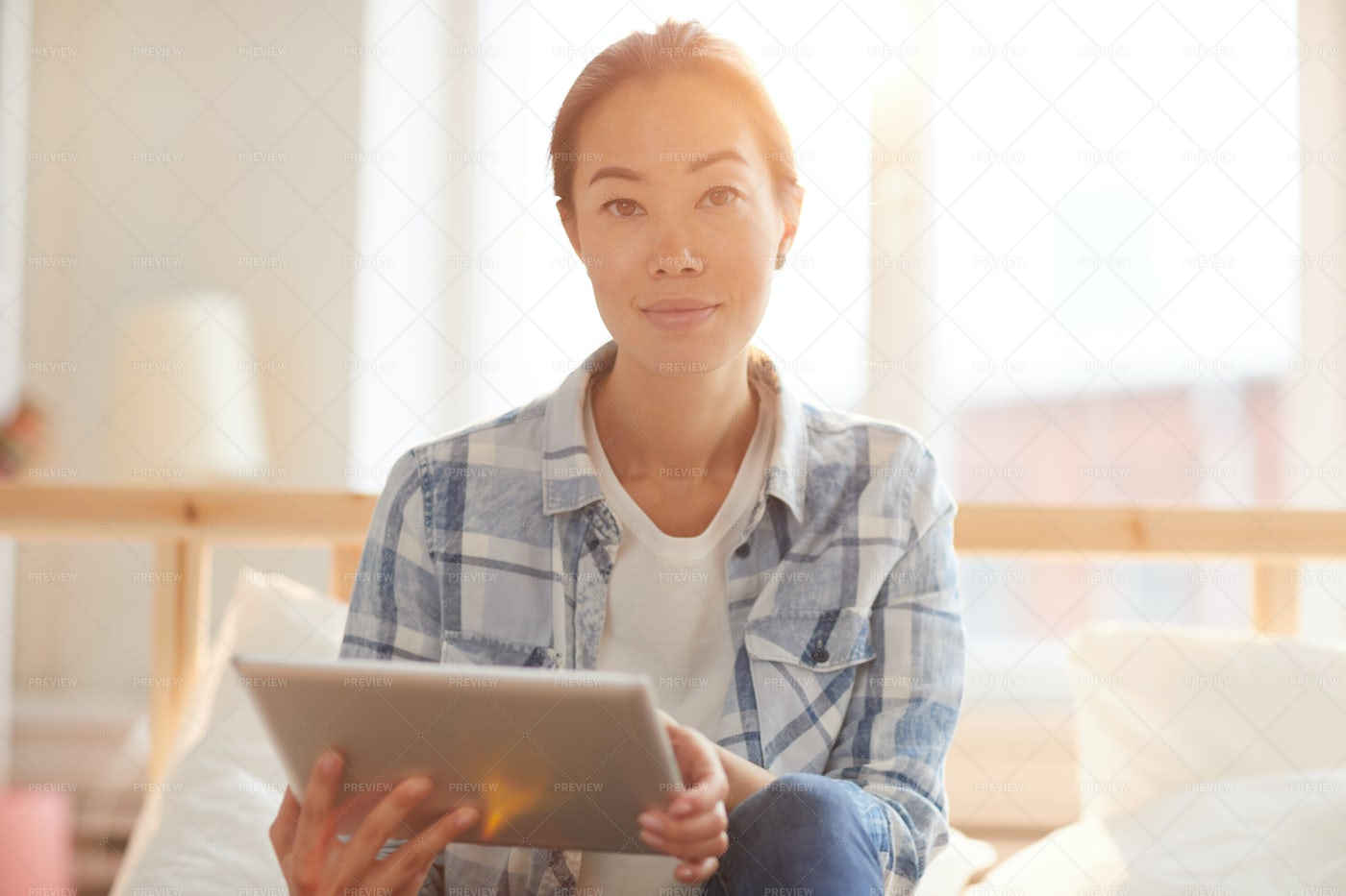 Asian Woman Using Tablet In...: Stock Photos