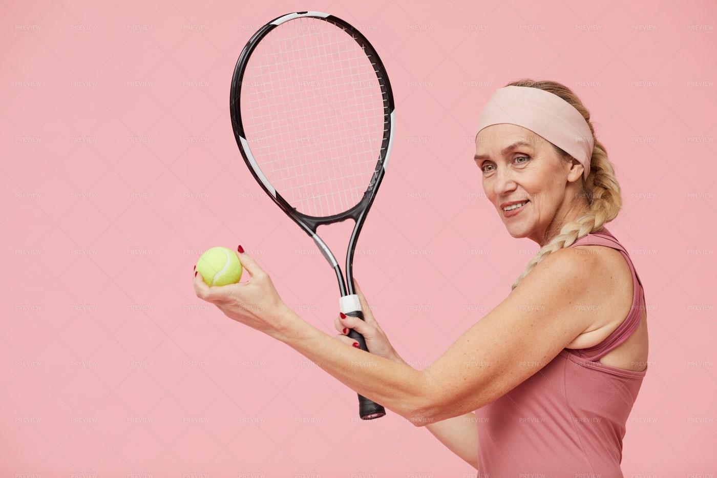 Sportive Woman Holding Ball: Stock Photos