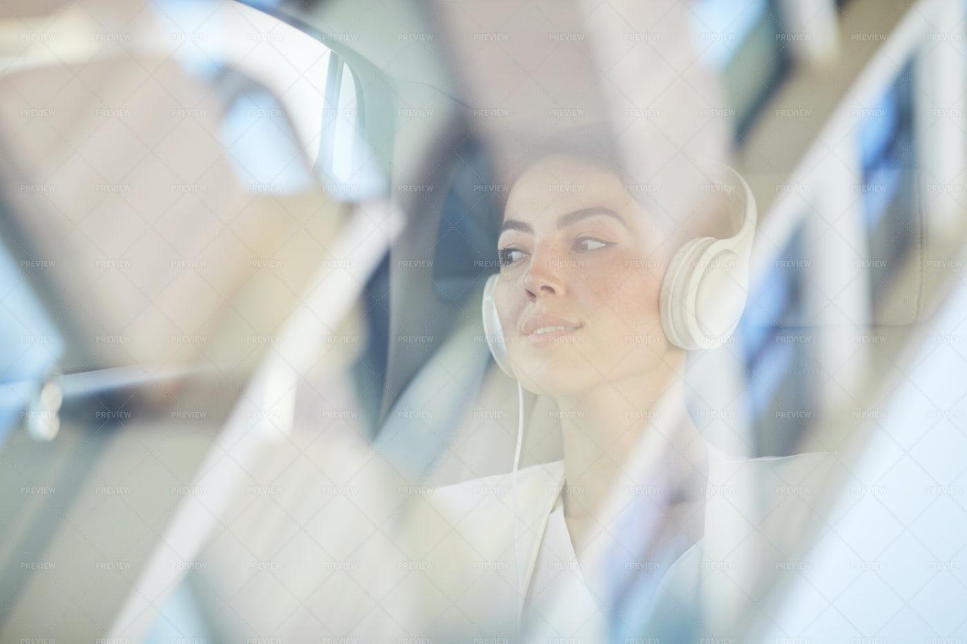 Young Woman Enjoying Taxi Ride: Stock Photos