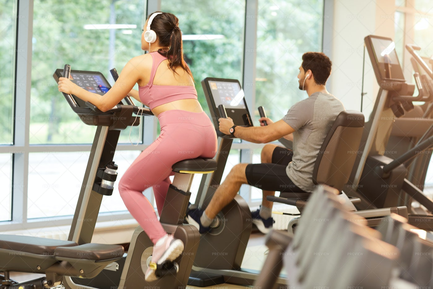 People Using Exercise Machines In...: Stock Photos